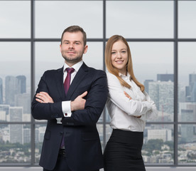 business couple are standing in office