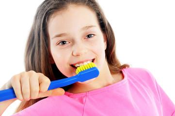 Close up portrait of cute girl brushing teeth