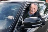 senior business man driving car
