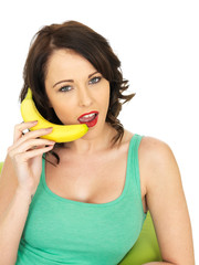 Young Woman Holding a Banana