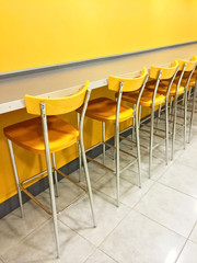 Bright cafeteria with a raw of chairs