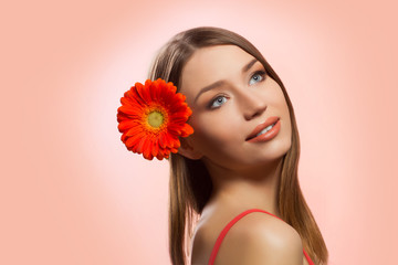 Beautiful woman face with  fresh flower