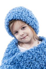 Portrait of little girl in blue winter clothes
