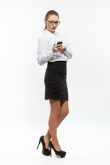 Young business woman looking message on cellphone