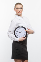 Woman in glasses with clock.