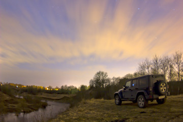 Jeep Wrangler on the forest river