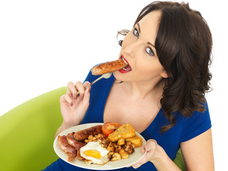 Young Woman Eating a Full English Breakfast