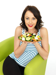 Young Woman Eating a Fresh Crispy Greek Salad