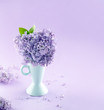 Blue vase with a bouquet of lilacs