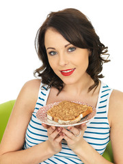 Young Woman Holding Toast with Crunchy Peanut Butter