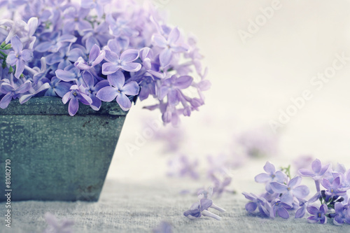 Fotobehang Lilac Vase with a bouquet of purple lilac spring flowers