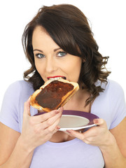 Young Woman Holding Toast Spread with Marmite