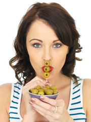 Young Woman Eating Green Olives