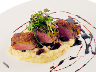 saddle of lamb with goat cheese, beans & polenta