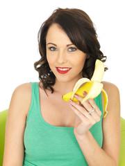 Young Woman Eating a Banana