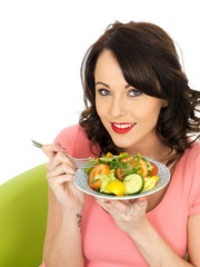 Young Woman Eating a Healthy Mixed Salad