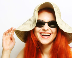 Fashion woman wearing sunglasses and hat.