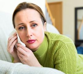 Sad broken woman at home