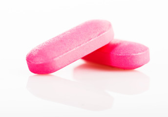 Group of pink medical pills isolated