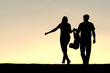 Silhouette of Family of Three People Walking at Sunset