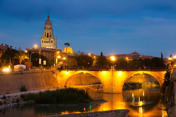 stone bridge over Segura river   in evening. Murcia