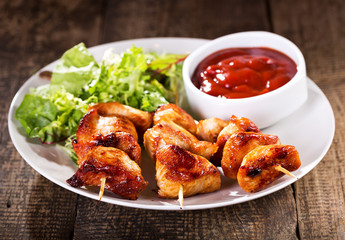 plate of grilled chicken with salad