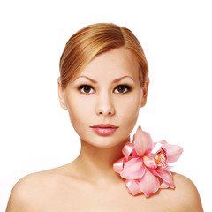 Beautiful young woman with orchid flower, isolated. Face Care