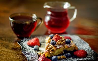 slice of apple pie with strawberries, blueberries