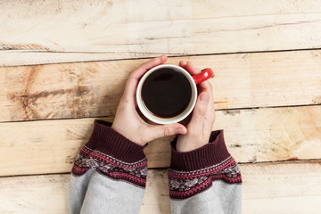 Woman hand with coffee.