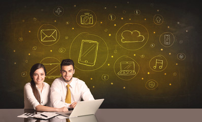 business couple with media icons background