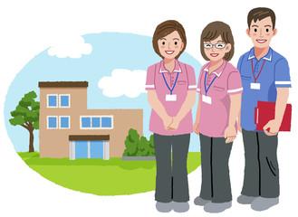 福祉士 福祉施設 Smiling caregivers with nursing house background