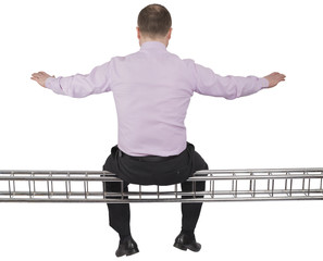 Businessman sitting on light metal girder beam on white