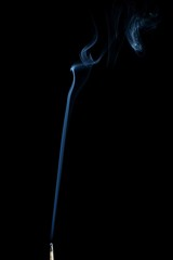 Matchstick with smoke trail isolated on black