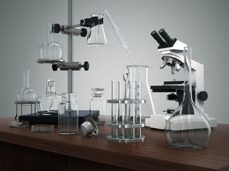 Test tubes with laboratory equipment and microscope on the table