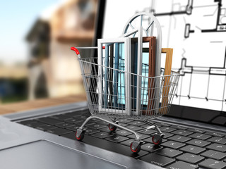 The windows in the shopping cart on notebook keyboard. E-commerc