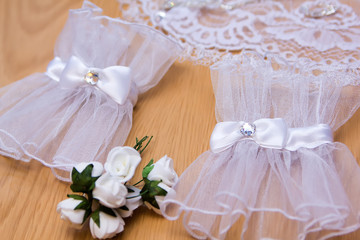 Delicate bride's gloves on the wooden background