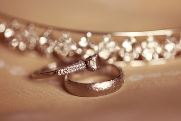 Wedding rings on a brown background