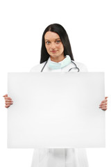Female doctor holding an blank advertisement board