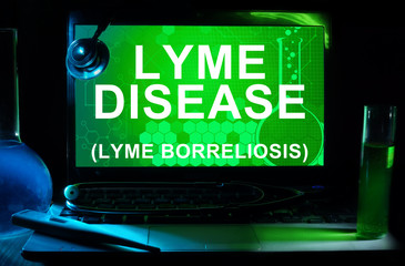 Computer with words Lyme disease (Lyme borreliosis).
