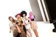 Leinwandbild Motiv Frauen machen Foto vor Photobooth