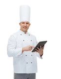 happy male chef cook holding tablet pc