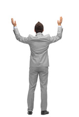 businessman raising hands up from back