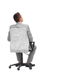 businessman sitting in office chair from back