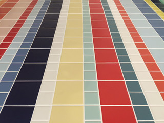 Colorful checked pattern of bathroom floor tiles