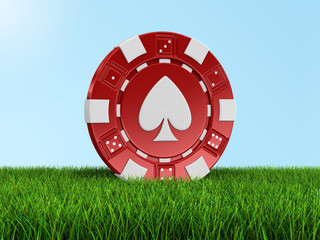 chip of casino on grass (clipping path included)