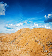 big pile of conatruction sand on background sky construction con