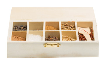 wooden box with spices different
