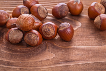 hazelnuts on vintage wooden board food and drink concept