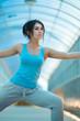 Woman doing stretching yoga exercises