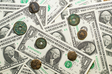 Antique  coins with portraits of emperors and banknotes of dolla